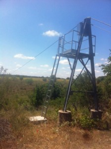 Protecting unguarded railing openings with ladder safety gates on a 12'h survey tower in Texas