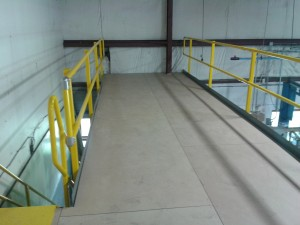 Top of deck view showing internal OSHA staircase and unfinished Resindek field cut around customer's existing building column