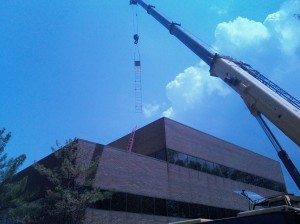 Crane lifting fixed ladder for installation