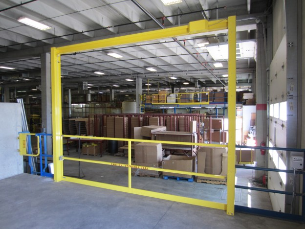 Vertical mezzanine gate in the down position