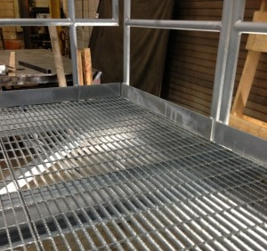 Galvanized serrated 19W4 open bar grating on a mezzanine deck
