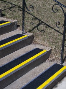 FloorMat-Store.com GSA9 Aluminum Stair Treads displaying a black tread with contrasting safety yellow leading edge