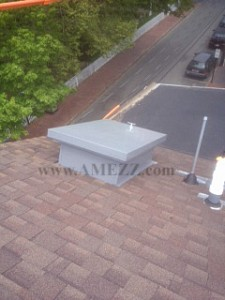 economy series roof hatch mounted on a pitched roof