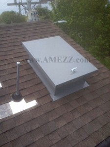 Economy series hatch installed on a shingled, sloped roof