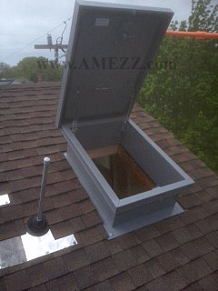 open roof hatch showing clearances on a sloped roof - Roof Hatch