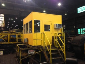 bright yellow steel mill control booth