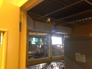 Exposed recessed beam in ceiling plenum of modular building control room