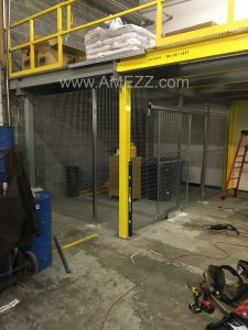 Lockable tool crib located under elevated platform with sliding door access