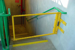 Stair safety gate mounted with the orientation requiring user to pull the gate towards them to walk downstairs. Coming upstairs, the user would simply push through the gate.