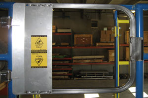 photo of a stainless steel ladder safety gate